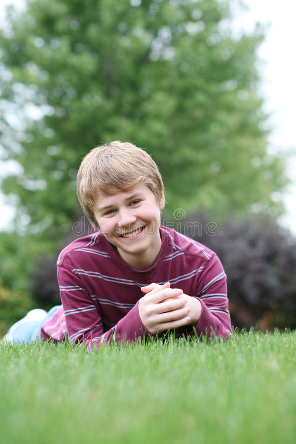 Download Preteen Boy Smiling In Grass Stock Image - Image of natural, cute: 21381693