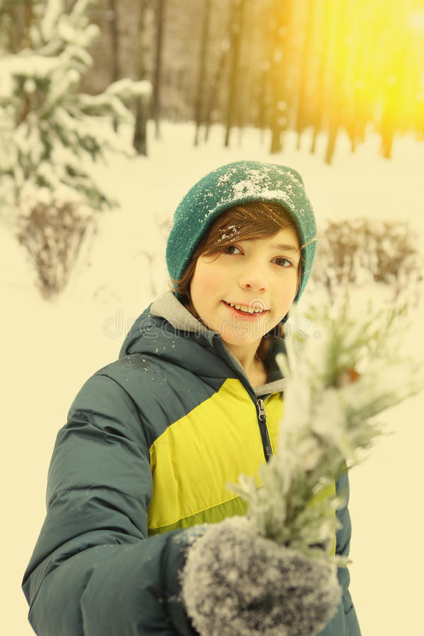 Preteen Boy With Snow Ball In Winter Park Stock Photo