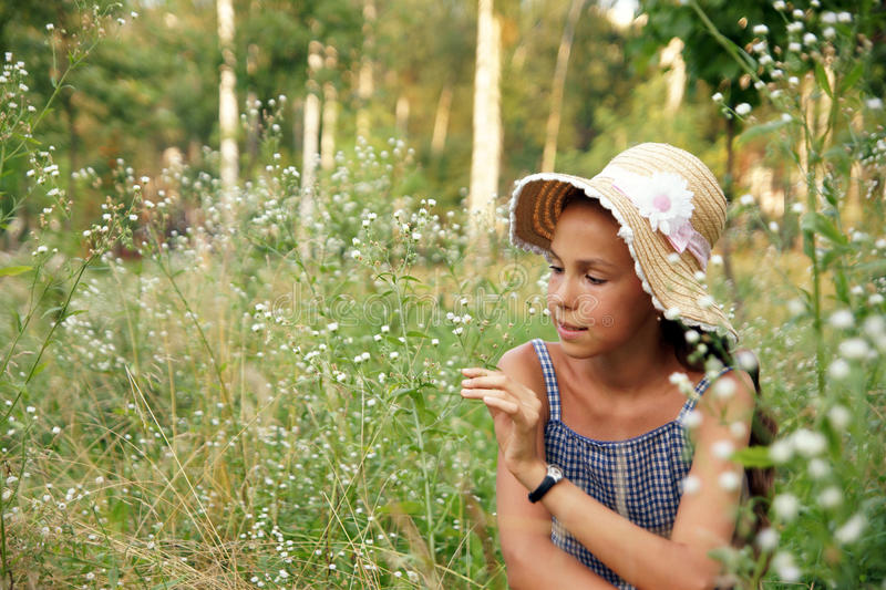 Preteen girl with flowers royalty free stock image