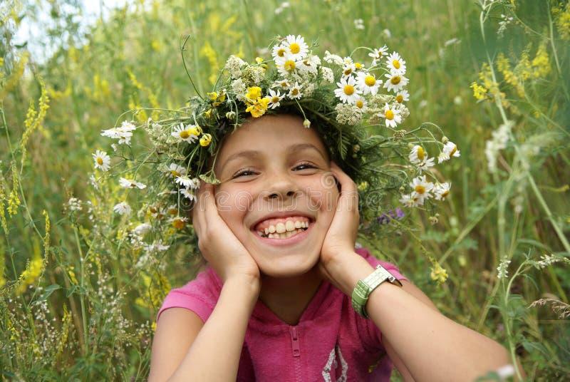 Preteen girl in garland stock photos