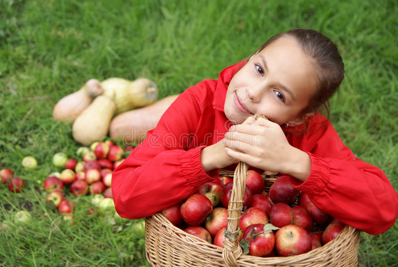 Preteen girl on grass stock photo
