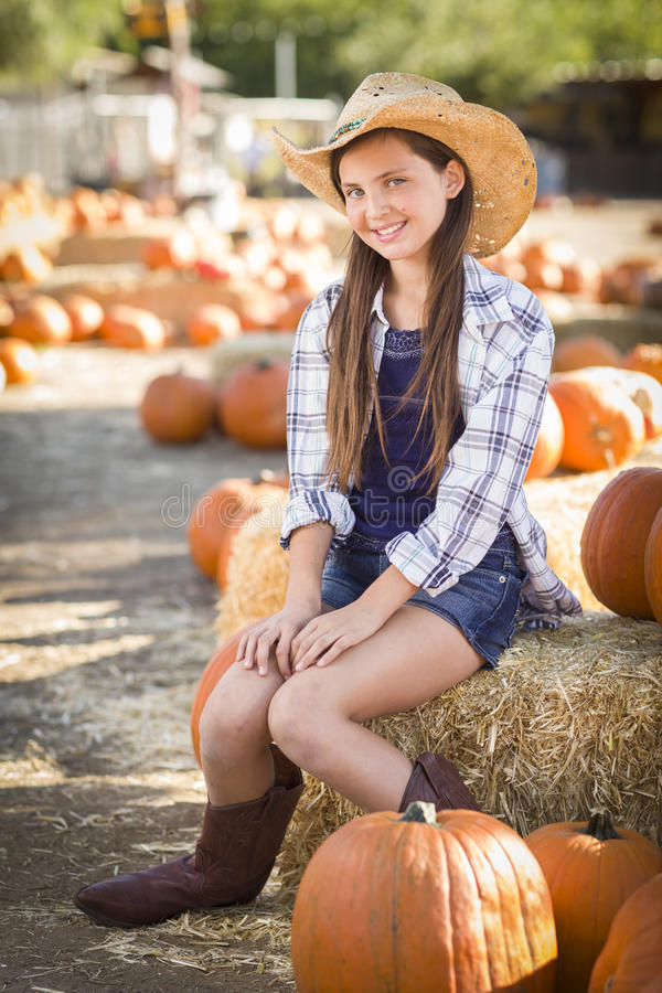 Preteen Girl Portrait at the Pumpkin Patch stock image