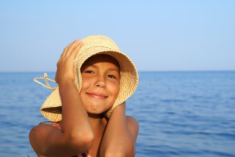Preteen girl on sea beach stock photo. Image of little