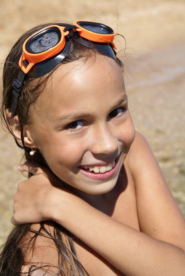 Preteen girl on sea beach royalty free stock photography