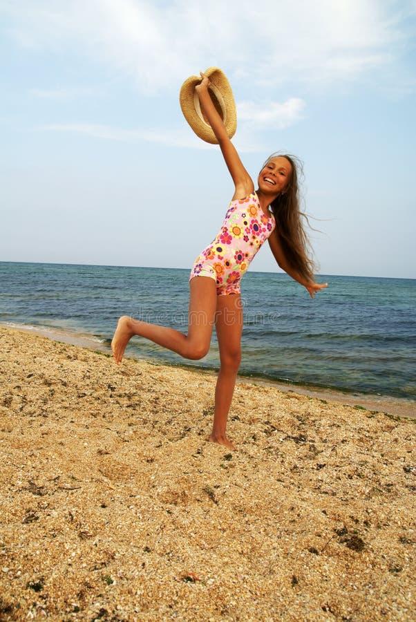 Preteen girl on sea beach royalty free stock photo