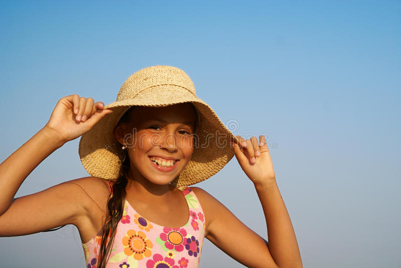 Preteen girl on sea beach royalty free stock photography
