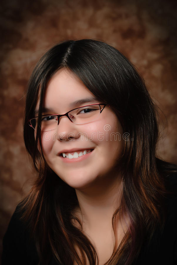 Preteen Portrait. A young preteen girl smiling for her portrait stock photos