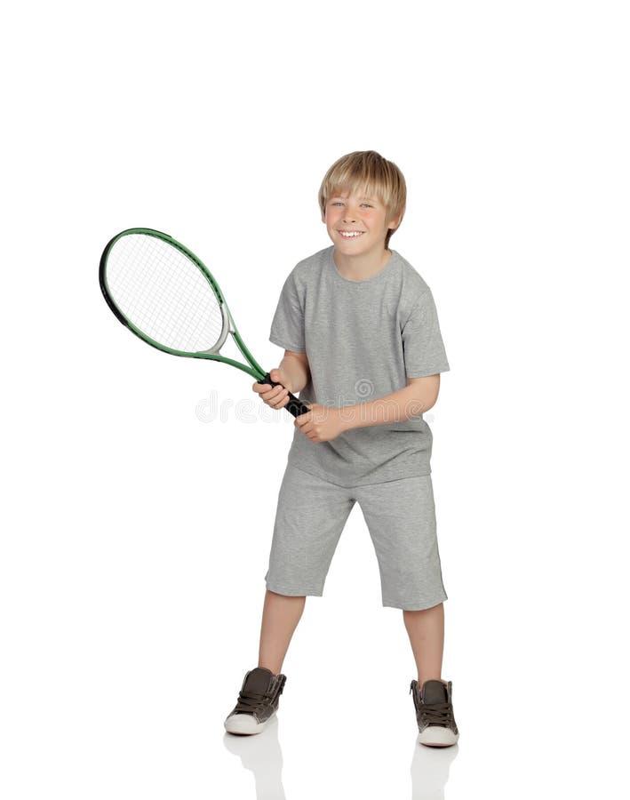 Preteen que joga o tênis que guardara a raquete imagens de stock royalty free
