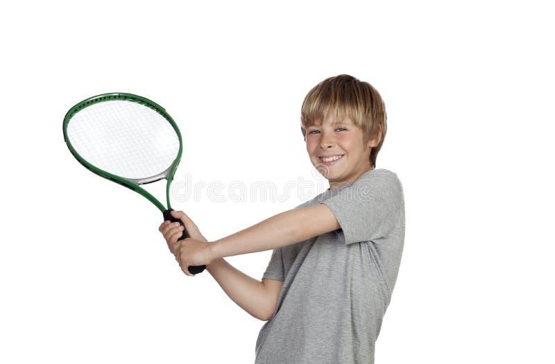 Preteen que joga o tênis que guardara a raquete fotografia de stock royalty free