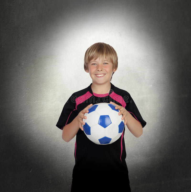 Preteen with a uniform for play soccer stock images