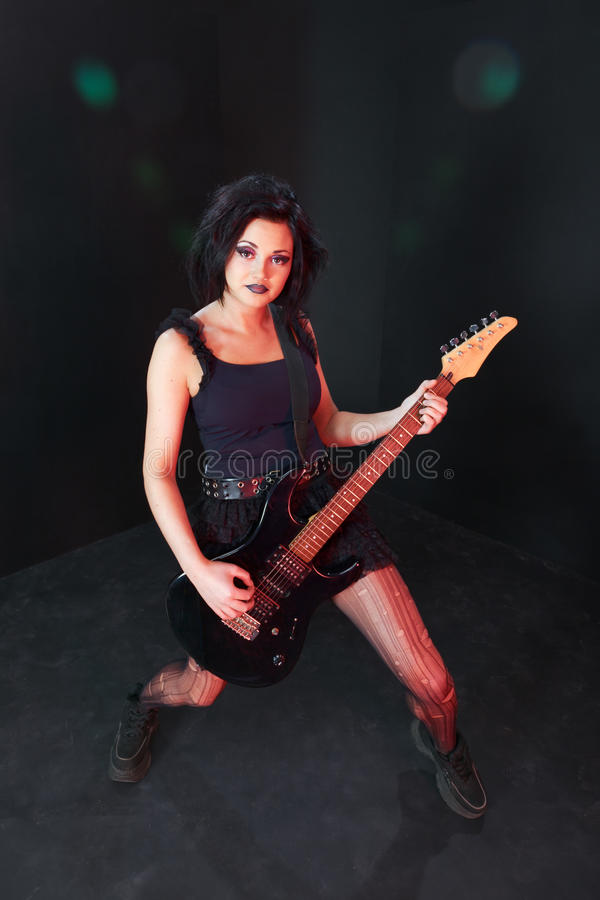 Pretending to be a rockstar. Young girl pretending to be a next rock superstar stock photo