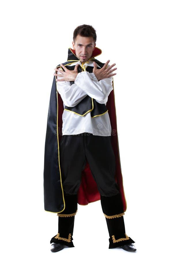 Pretensjonalny mężczyzna pozuje w kostiumu iluzjonista zdjęcia stock