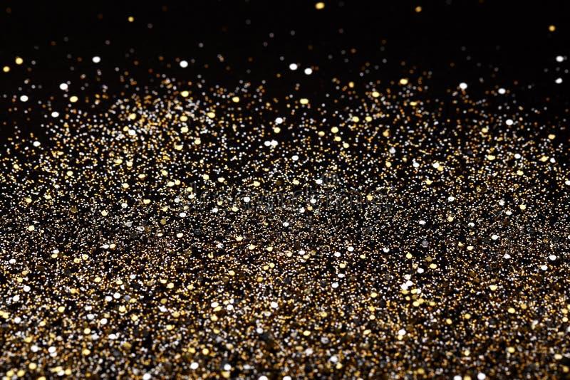 Preto do ano novo do Natal e fundo do brilho do ouro Tela abstrata da textura do feriado