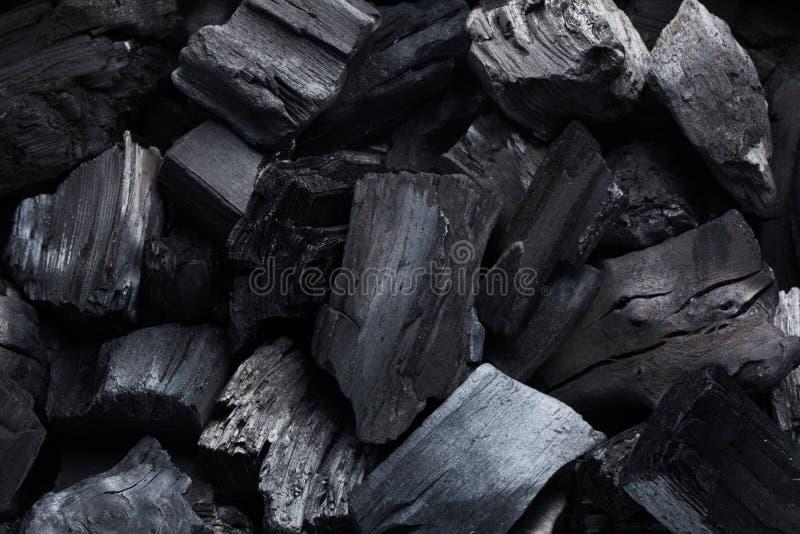 Preto mineral de carvão como um fundo da pedra do cubo foto de stock