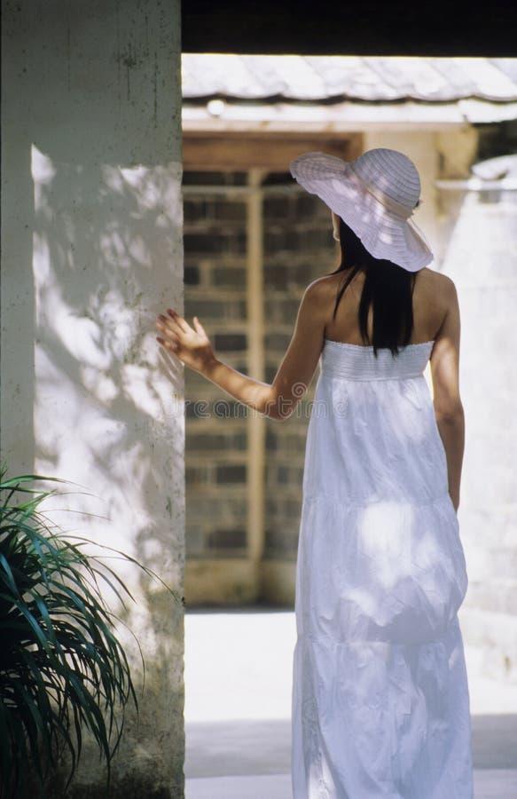 Prettey woman at door stock photos