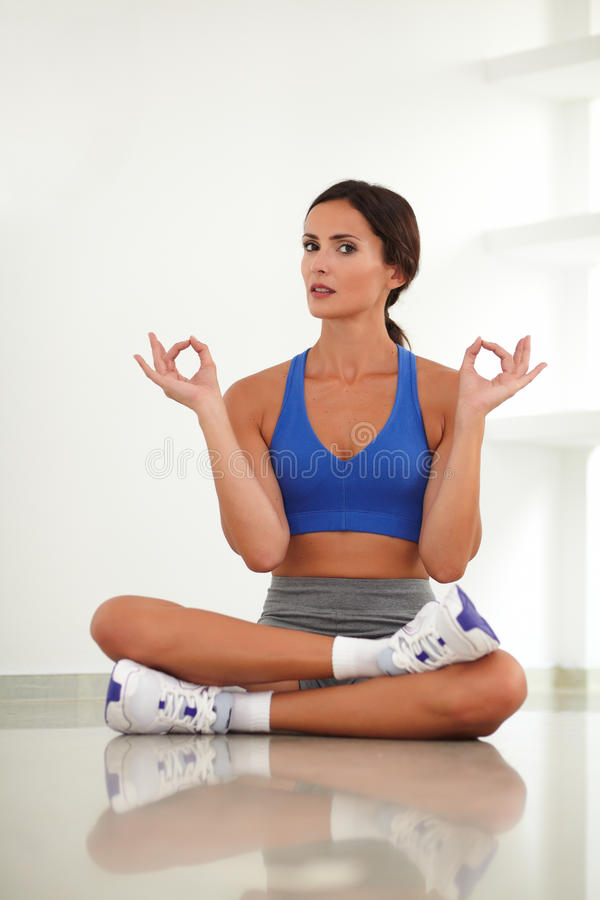 Pretty adult woman exercising in yoga class royalty free stock images