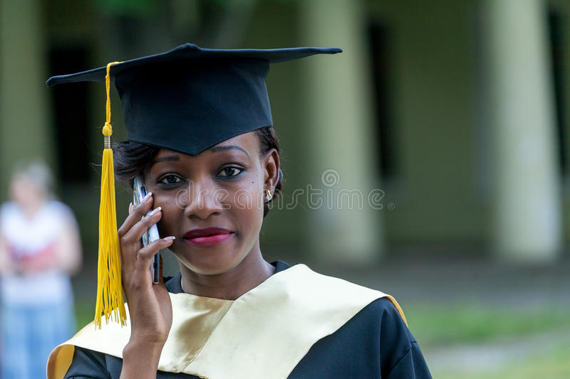 Pretty african female college graduate at graduation stock image