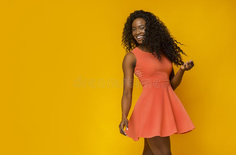Pretty african female model in summer dress posing at camera stock photography