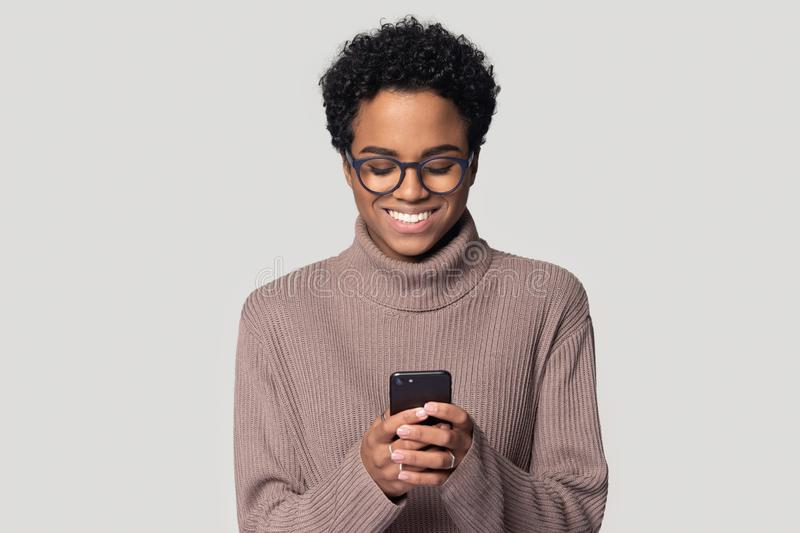 African woman holding smartphone makes order online studio shot royalty free stock photos