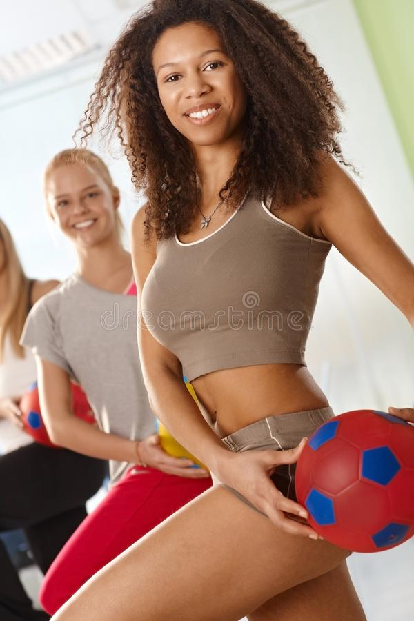 Download Pretty Afro Woman Exercising With Ball Stock Image - Image: 26681001