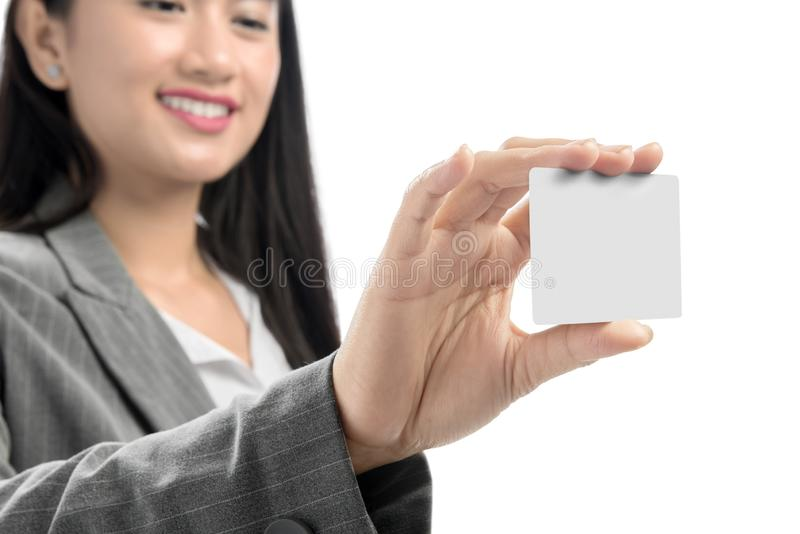 Pretty asian business woman showing blank business card on her hand standing stock photography