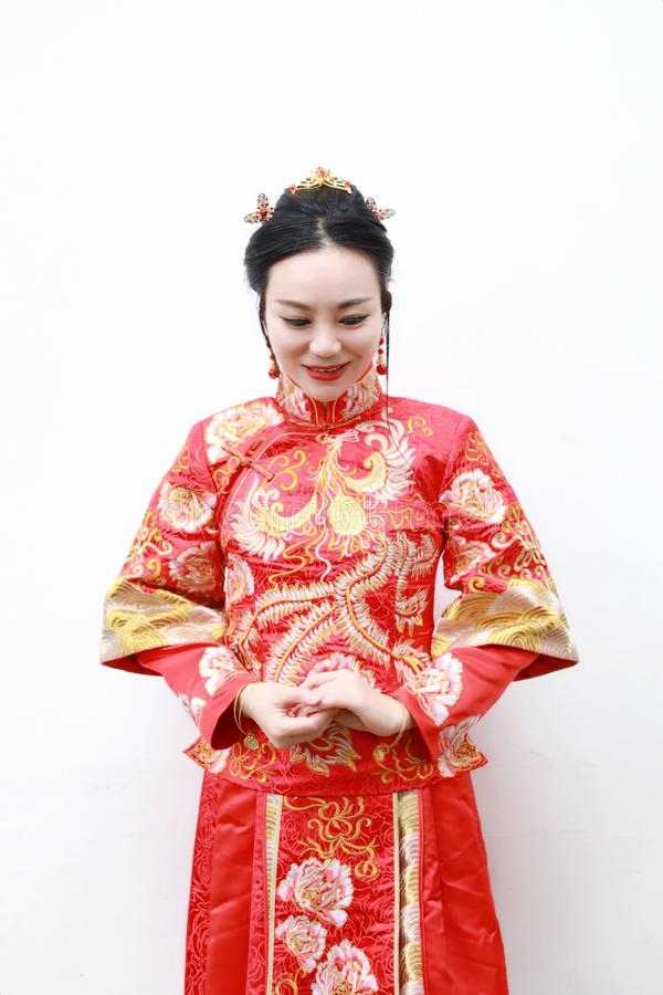 Pretty Asian Chinese beautiful Bride with Traditional chinese wedding dress royalty free stock photo