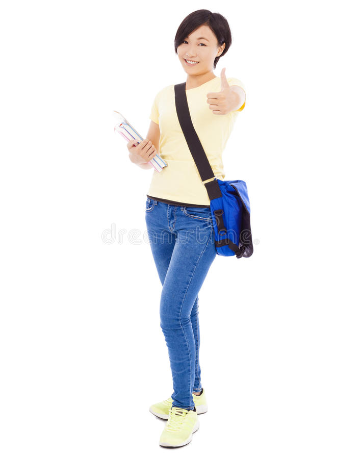 Pretty asian college student holding book over white background stock photography