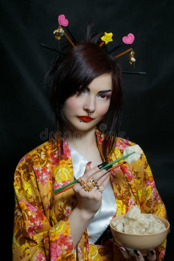 Pretty asian girl with russian pelmeni royalty free stock images