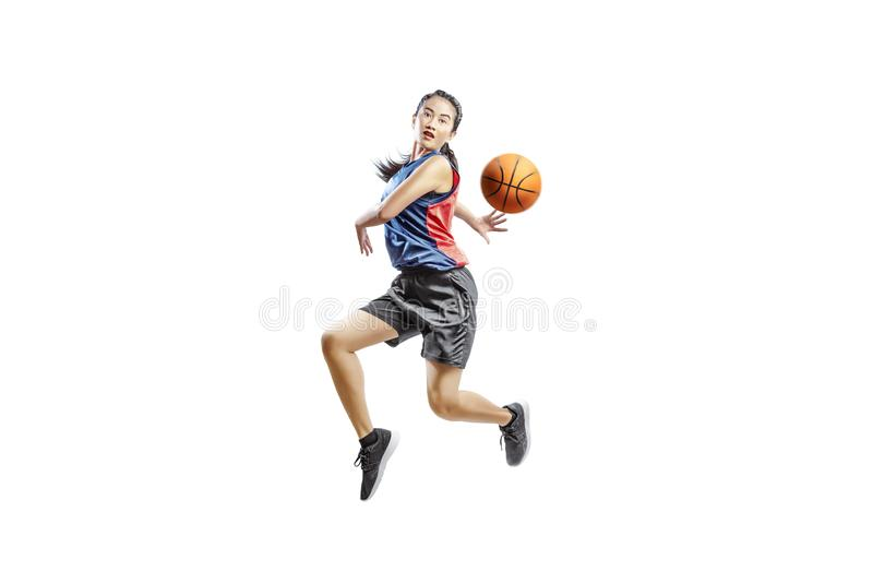Pretty asian woman playing basketball royalty free stock image
