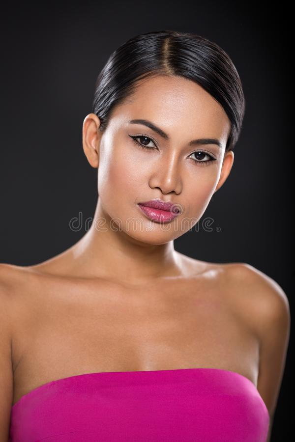 Pretty Asian woman, portrait over black royalty free stock photography