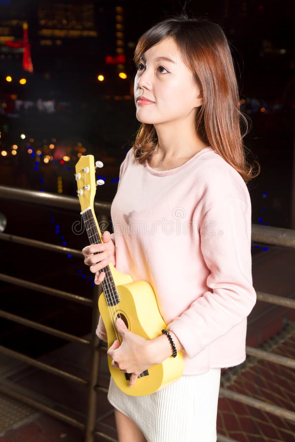 Pretty Asian woman with ukelele stock photo