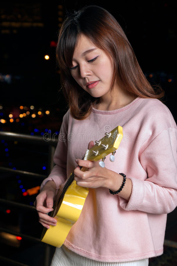 Pretty Asian woman with ukelele royalty free stock photos