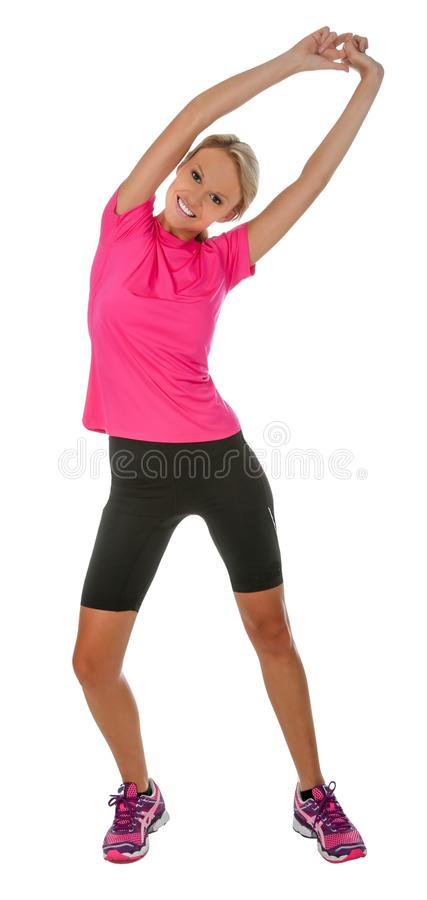 Pretty Athlete Stretching. Healthy young blond lady jogging or running isolated on white stock photo