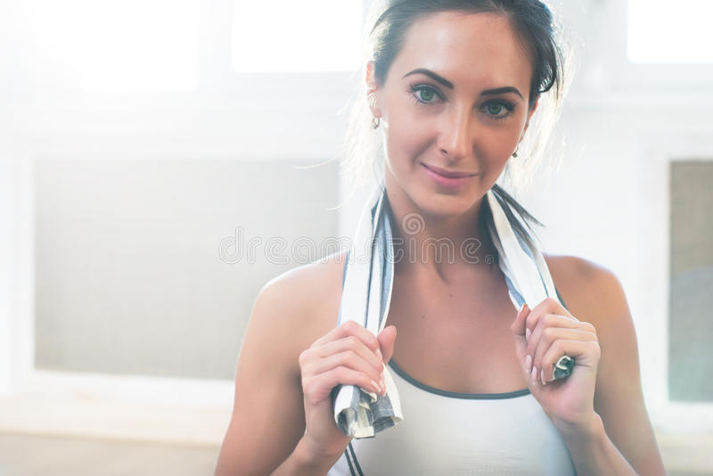 Pretty athletic sporty girls is smiling holding a royalty free stock image