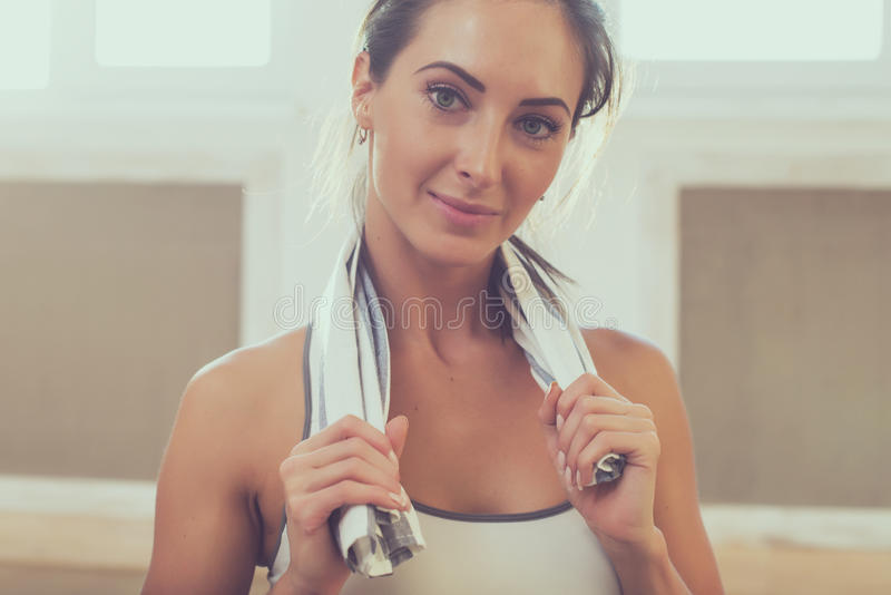 Pretty athletic sporty girls is smiling holding a stock photos