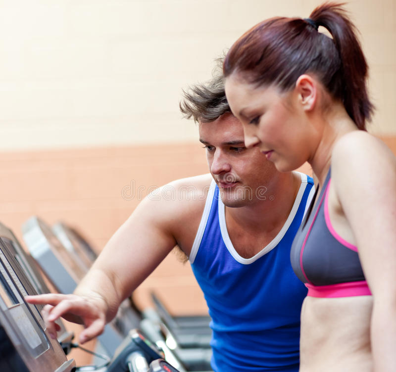 Pretty Athletic Woman Standing On A Treadmill Stock Images