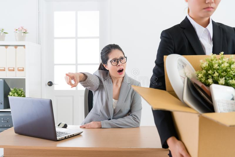 Business manager shouting blame employee girl. Pretty attractive business manager shouting blame employee girl and fired her leaving company stock images