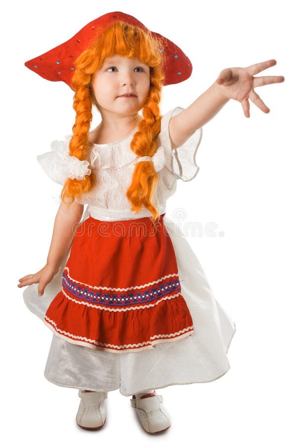Pretty baby in festival dress. Red hat and red plait over white background stock image