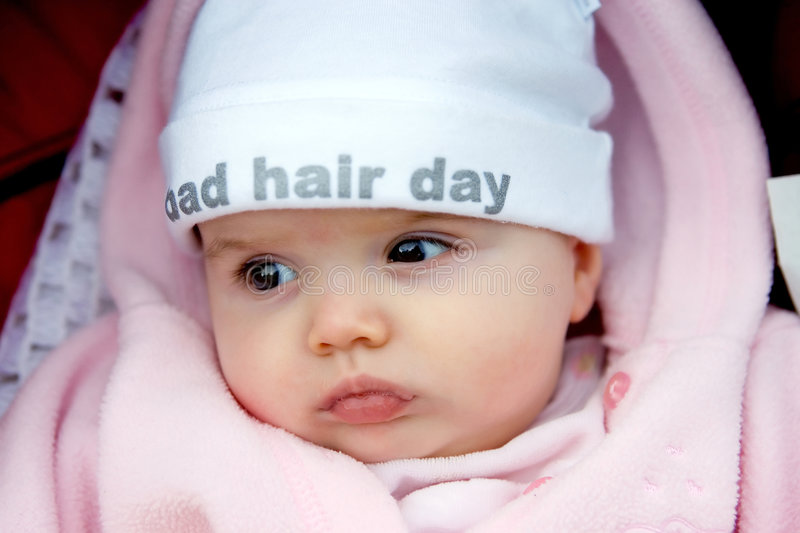 Pretty baby girl with funky hat on royalty free stock images