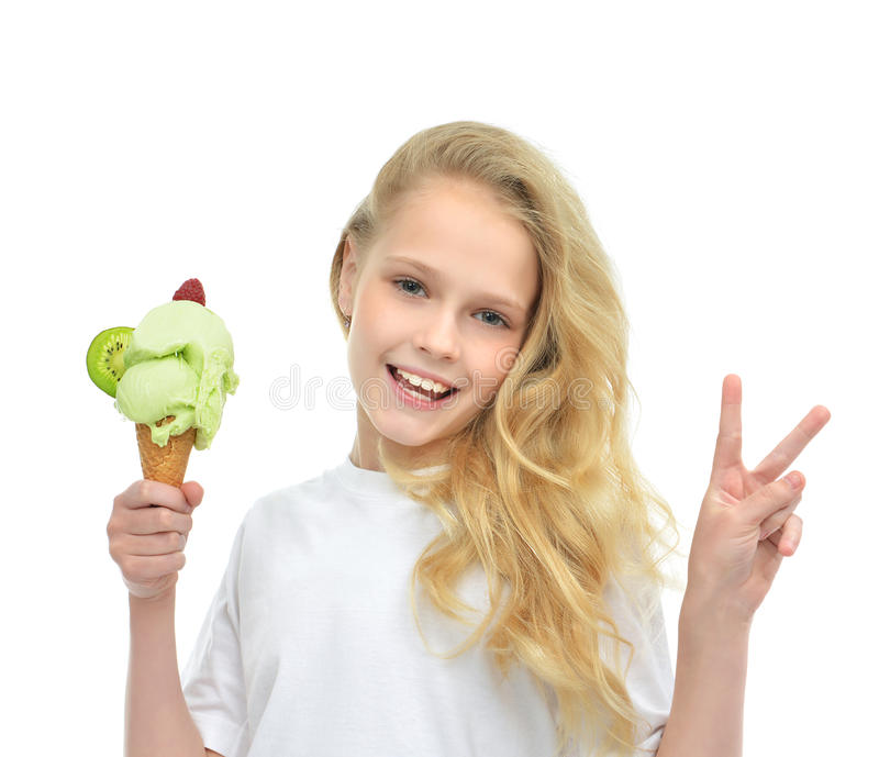 Pretty baby girl holding ice cream showing peace sign royalty free stock photos
