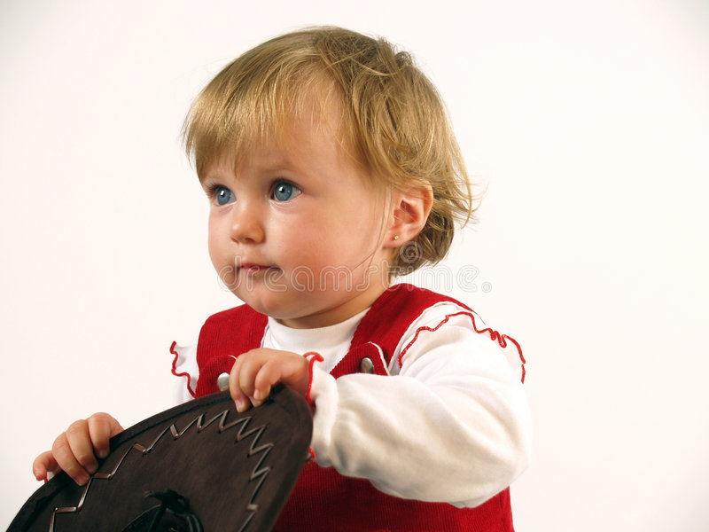 Pretty baby girl playing royalty free stock images