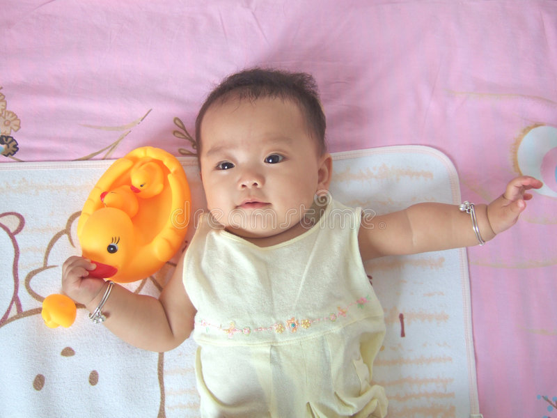 Download Pretty baby and toy ducks stock photo. Image of angel - 6616642