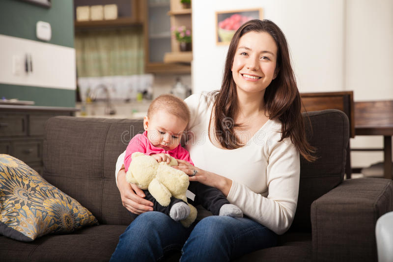 Pretty Babysitter With A Baby Girl Stock Image - Image of brunette ...