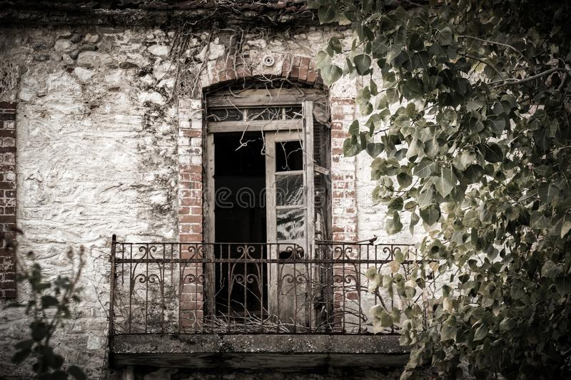 Pretty balcony in abandoned building in Greece. royalty free stock image