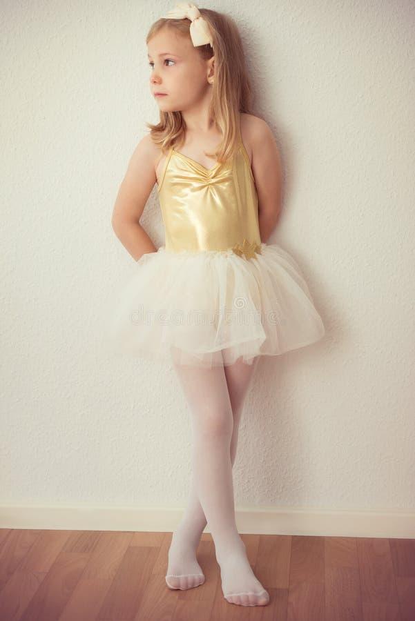 Pretty ballet child girl in white tutu staying stock image