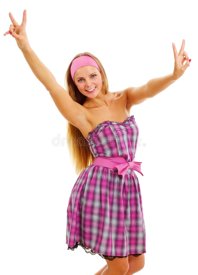 Pretty barbie girl showing V sign. Beautiful smiling barbie girl in pink dress and headscarf showing victory symbol isolated on white background. Mask included royalty free stock photo
