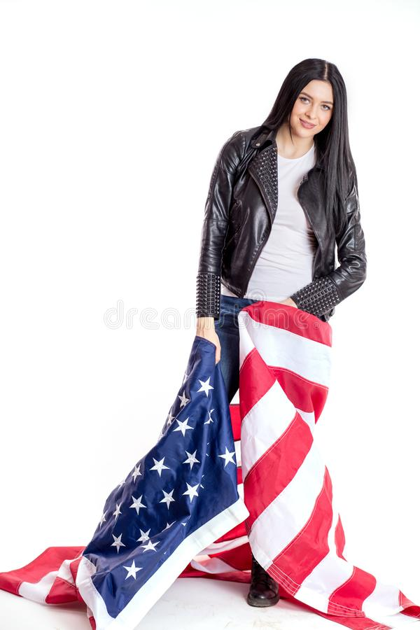 Pretty, beautiful, blak-haired woman with american flag wrapped around her stock image