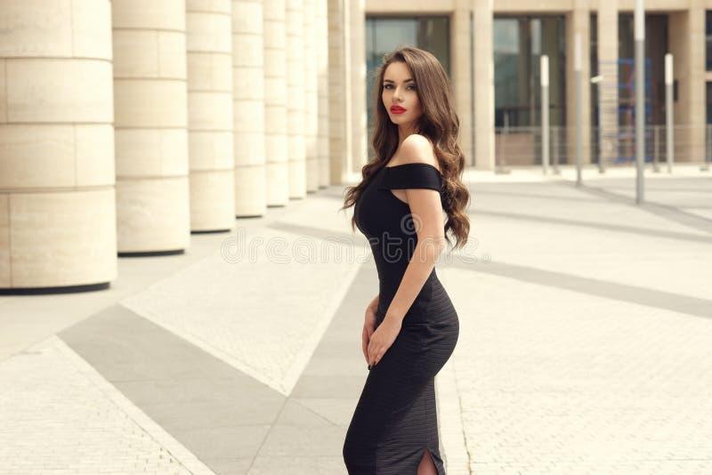 Pretty beautiful business woman in elegant black dress stock photo