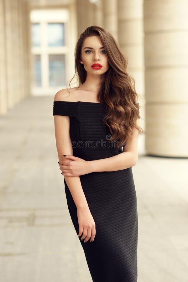 Pretty beautiful business woman in elegant black dress royalty free stock image
