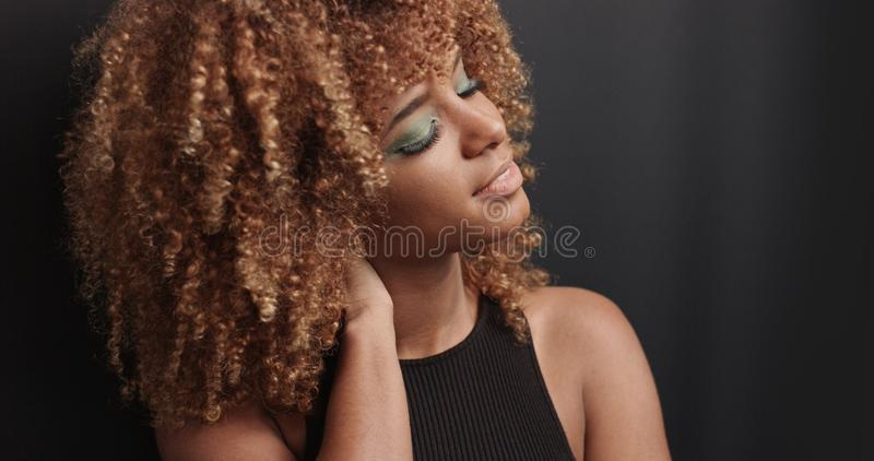 Pretty black girl with big hair posing video royalty free stock photography
